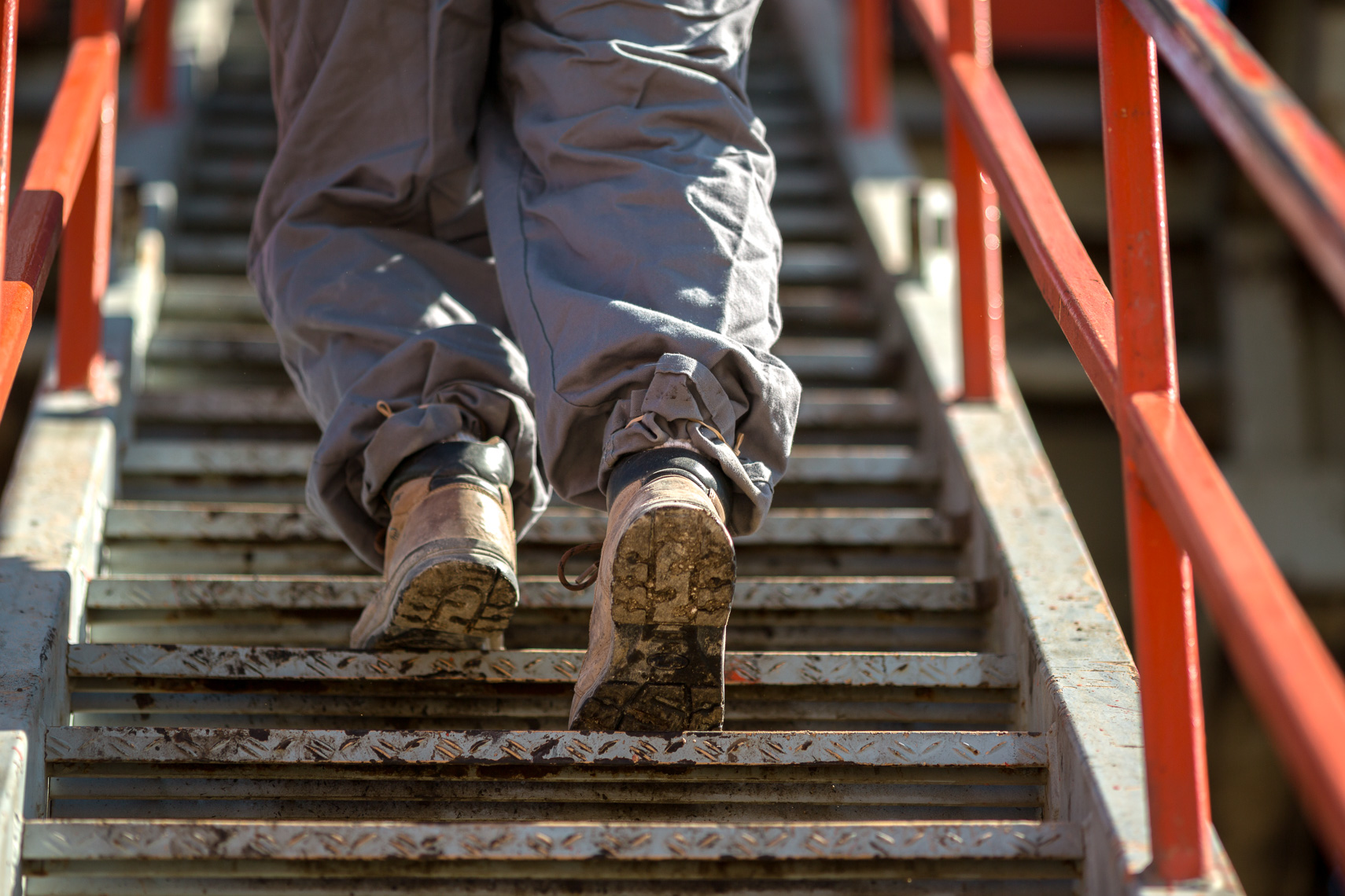 Oil & Gas Worker Walking Up Stairs - Photographed By Jason Risner of San Antonio, Texas